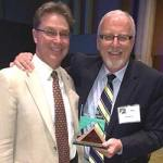 Tony Fagnant and Bill Morris holding the Samaritan Institute Award